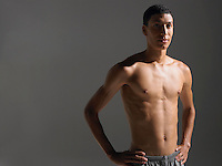 Shirtless young athlete standing portrait