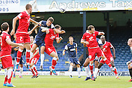 Picture by David Horn/Focus Images Ltd +44 7545 970036.18/08/2012.Mark Phillips of Southend United (blue) in an aerial attack during the npower League 2 match at Roots Hall, Southend.