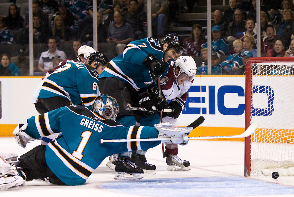 March 28, 2010; San Jose, CA, USA; Colorado Avalanche right wing Peter Mueller (88) scores past San Jose Sharks goalie Thomas Greiss (1) and defenseman Niclas Wallin (7) and center Joe Pavelski (8) during the third period at HP Pavilion. San Jose defeated Colorado 4-3. Mandatory Credit: Jason O. Watson / US PRESSWIRE
