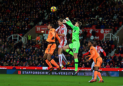 STOKE-ON-TRENT, ENGLAND - Wednesday, November 29, 2017: Liverpool's captain goalkeeper Simon Mignolet and Joel Matip challenge Stoke City's Peter Crouch during the FA Premier League match between Stoke City and Liverpool at the Bet365 Stadium. (Pic by David Rawcliffe/Propaganda)