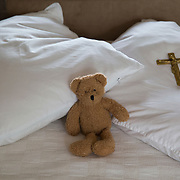 A stuffed bear and crucifix lie on the pillow of Hermit Sister Rachel Denton's bed in St Cuthberts' Hermitage in Lincolnshire, north east Britain August 24, 2015. Sister Rachel Denton has vowed to spend the rest of her life living as a consecrated hermit in the Catholic faith. A hermit is a person who chooses to live alone, with the intention of finding God. Rarely leaving her house she lives a life of prayer and solitude. However, she uses the internet and social media to share her experience and distance her self from physically interacting with society. REUTERS/Neil Hall