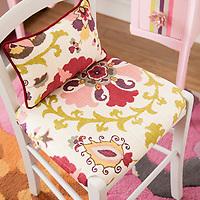 Reupholstered desk chair on rug