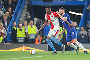 Chelsea forward Olivier Giroud (18) attempts to gain possession of the ball from Slavia Prague defender Simon Deli (19) during the Europa League  quarter-final, leg 2 of 2 match between Chelsea and Slavia Prague at Stamford Bridge, London, England on 18 April 2019.