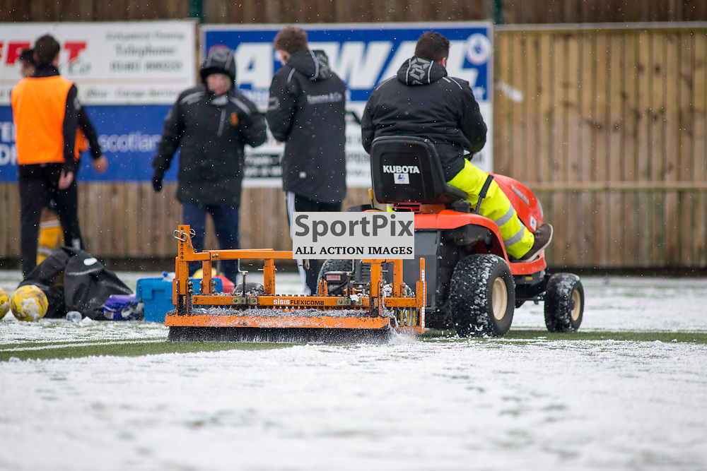 Annan Athletic v Easty Fife SPFL2 16 January 2016<br />Ground staff try to clear the snow,<br />(c) Russell G Sneddon / SportPix.org.uk