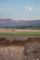 """""""Full Moon Over Prosser 3""""- Photograph of a full moon rising over the mountains at a very low Prosser Reservoir near Truckee, California."""