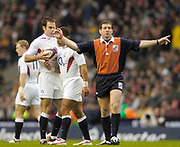 2004 England vs South Africa - Investec Challenge - Twickenham..Referee Alain Rolland [IRL} signals a kick...20.11.2004 Photo  Peter Spurrier. .email images@intersport-images.com...