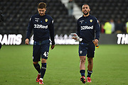Man of the match Leeds United striker Kemar Roofe (7) leaves the pitch with Leeds United midfielder Mateusz Klich (43) during the EFL Sky Bet Championship match between Derby County and Leeds United at the Pride Park, Derby, England on 11 August 2018.