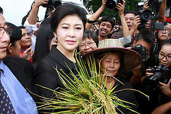 July 21, 2017 - Thailand - Former Thai Prime Minister Yingluck Shinawatra greets supporters as she arrives at the Supreme Court in Bangkok during a final court hearing expected in the negligence trial of ousted Yingluck, who faces up to a decade in jail in a case lambasted by her supporters as politically motivated. (Credit Image: © Vichan Poti/Pacific Press via ZUMA Wire)