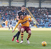 24th February 2018, Dens Park, Dundee, Scotland; Scottish Premier League football, Dundee versus Motherwell; Charles Dunne of Motherwell hold off Steven Caulker of Dundee