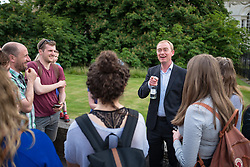 © Licensed to London News Pictures. 31/05/2017. Cambridge, UK. Leader of the Liberal Democrats TIM FARRON (centre) speaks with members of the public outside Senate House in Cambridge. Farron will appear in the BBC General Election Debate this evening. Photo credit: Rob Pinney/LNP