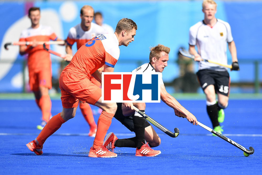 Netherlands' Mirco Pruijser (L) and Germany's Niklas Wellen vie during the mens's field hockey Germany vs Netherlands match of the Rio 2016 Olympics Games at the Olympic Hockey Centre in Rio de Janeiro on August, 12 2016. / AFP / MANAN VATSYAYANA        (Photo credit should read MANAN VATSYAYANA/AFP/Getty Images)