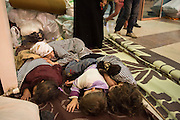 Kilis, near Syrian - Turkish border, newly arrived refugees from Aleppo sleep in a bus station.  Because Turkey is saturated with refugees, they will likely get no help, no work, and no place in a refugee camp. Many refugees return to Aleppo after a few month in Turkey, a country that is now saturated with refugees.