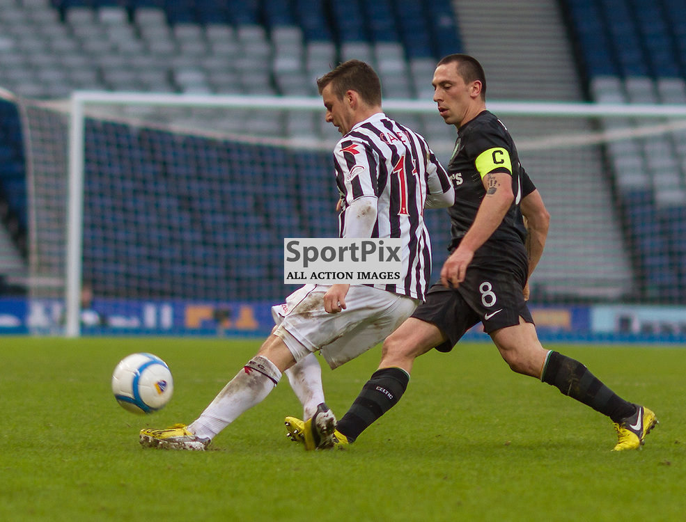 graham carey and scott brown challenging for the ball