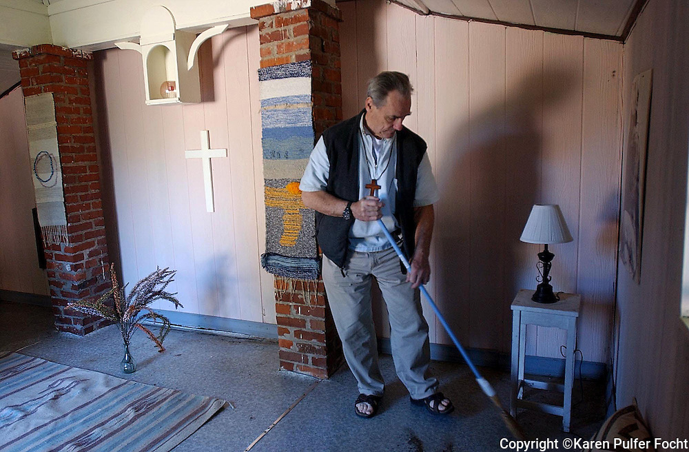 Father David Knight sweeps a room of the monastary where he lives with the dwindling Poor Clare nuns in Memphis, Tennessee.