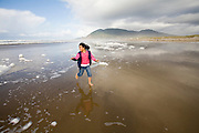 nine year old Vira Halim-Rotinsulu runs on the beach at the Oregon Coast.<br /> (Fully released - 111106)<br /> nine year old Vira Halim-Rotinsulu runs on the beach at the Oregon Coast.<br /> (Fully released - 111106)