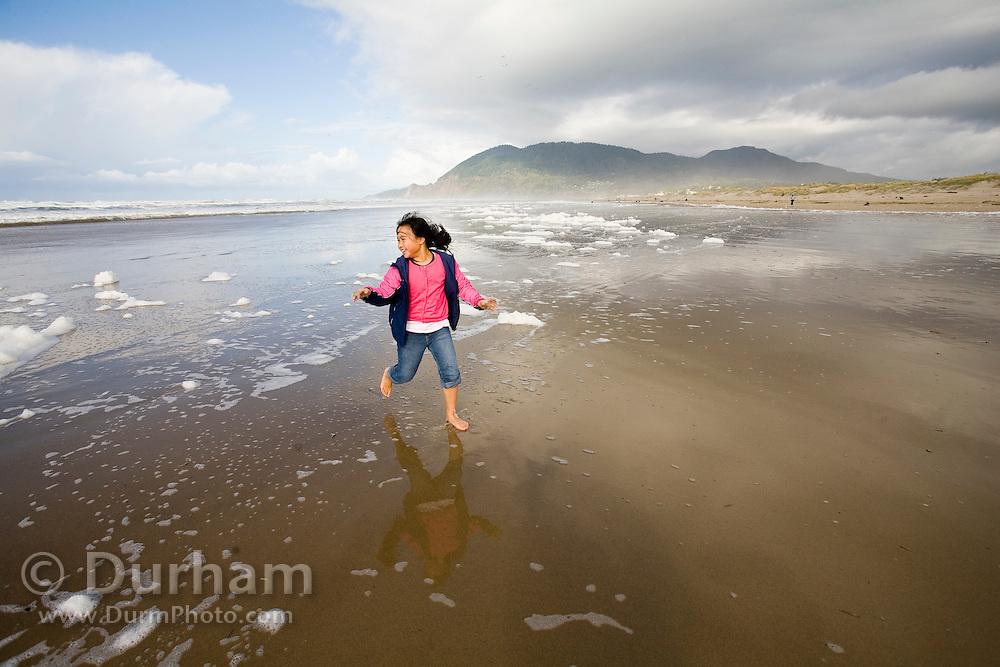 nine year old Vira Halim-Rotinsulu runs on the beach at the Oregon Coast.<br /> (Fully released - 111106)<br /> nine year old Vira Halim-Rotinsulu runs on the beach at the Oregon Coast.<br /> (Fully released - 111106)