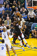 Houston Rockets guard Patrick Beverley (2) takes the ball to the basket against the Golden State Warriors at Oracle Arena in Oakland, Calif., on March 31, 2017. (Stan Olszewski/Special to S.F. Examiner)