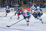 KELOWNA, CANADA - MARCH 24:  Dillon Dube #19 of the Kelowna Rockets, Carsen Twarynski #18 of the Kelowna Rockets, Libor Zabransky #7 of the Kelowna Rockets, Isaac Johnson #23 of the Tri-City Americans skate down the ice at the Kelowna Rockets game on March 24, 2018 at Prospera Place in Kelowna, British Columbia, Canada.  (Photo By Cindy Rogers/Nyasa Photography,  *** Local Caption ***