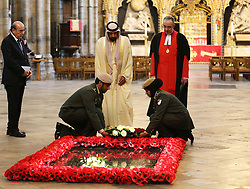 The President of the United Arab Emirates, Sheikh Khalifa bin Zayed Al Nahyan lays a wreath with the Very Rev Dr.John Hall, Dean of Westminster, at the Grave of the Unknown Warrior in Westminster Abbey, London,  on the second day of his state visit,  Wednesday 1st May 2013.  Photo by: Stephen Lock / i-Images