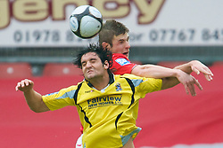 WREXHAM, WALES - Saturday, February 14, 2009: Wrexham's Mike Williams in action against Grays Athletic's Jamie Slabber during the Blue Square Premier League match at the Racecourse Ground. (Mandatory credit: David Rawcliffe/Propaganda)