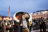 "VATICAN CITY - 12 MARCH 2013: A man in Saint Peter's Square waits for the ""fumata"" (or smoke), which is the announcement to the outer world by a conclave that a Papal has or hasn't been elected (white smoke if it has been electe; black smoke if it hasn't), in Vatican City, on March 12, 2013...On March 12, 2013, the 115 cardinals entered the conclave to elect a successor to Pope Benedict XVI after he became the first pope in 600 years to resign from the role. The conclave will take place inside the Sistine Chapel and will be attended by 115 cardinals as they vote to select the 266th Pope of the Catholic Church."