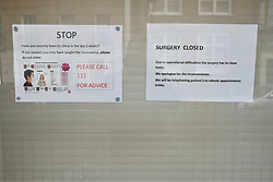 © Licensed to London News Pictures. 13/02/2020. London, UK. A notice on the front door of Ritchie Street Health Centre in Islington which had closed due to the Coronavirus COVID-19 outbreak, according to a notice on its website. Photo credit: Ben Cawthra/LNP