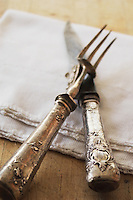 Antique Silver carving set on kitchen towel