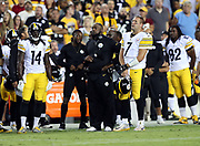 Pittsburgh Steelers head coach Mike Tomlin and Pittsburgh Steelers quarterback Ben Roethlisberger (7) and Steelers players stand at attention during the playing of the National Anthem before the 2016 NFL week 1 regular season football game against the Washington Redskins on Monday, Sept. 12, 2016 in Landover, Md. The Steelers won the game 38-16. (©Paul Anthony Spinelli)
