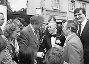 "Taoiseach's Election Campaign.      (N77)..1981..23.05.1981..05.23.1981..23rd May 1981..On the 21st May the Taoiseach, Mr Charles Haughey, dissolved the Dáil and called a general election. Charles Haughey, Garret Fitzgerald and Frank Cluskey were leading their respective parties into a general election for the first time as they had only taken party leadership during the last Dáil..Fianna Fáil had hoped to call the election earlier, but the Stardust Tragedy caused the decision to be deferred...Image of Charles Haughey, Eileen Lemass and Liam Lawler on the campaign trail with supporters in Lucan. Included in the picture is ""Lucan Lord Mayor"" candidate, Dinny Byrne (bow tie)."