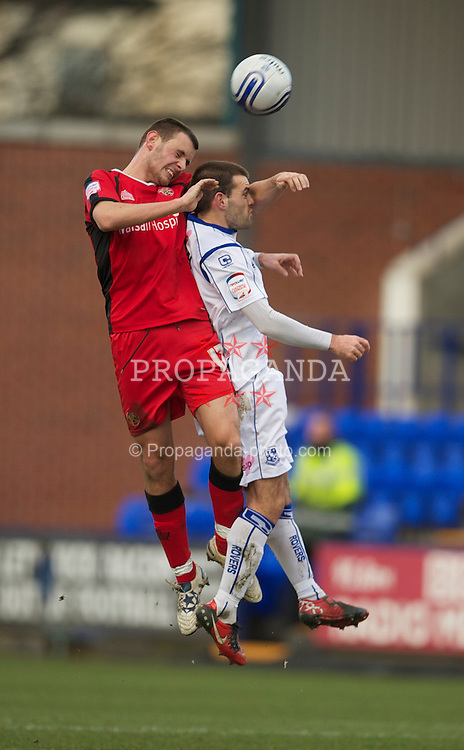 BIRKENHEAD, ENGLAND - Saturday, January 8, 2011: Tranmere Rovers' John Welsh in action against Walsall's Paul Marshall during the Football League One match at Prenton Park. (Pic by: David Rawcliffe/Propaganda)