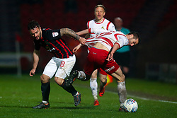 Adam Armstrong of Blackburn Rovers goes past Matty Blair of Doncaster Rovers - Mandatory by-line: Robbie Stephenson/JMP - 24/04/2018 - FOOTBALL - The Keepmoat Stadium - Doncaster, England - Doncaster Rovers v Blackburn Rovers - Sky Bet League One