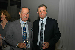 Left to right, JOHN RITBLAT and VISCOUNT ASTOR at an exhibition of work by Rolf Sachs - a unique world-renowned contemporary furniture designer, held in association with the Louisa Guinness Gallery and held at 250 Brompron Road, London on 6th October 2004.<br />