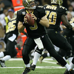 2007 December, 2: New Orleans Saints quarterback Drew Brees (9) drops back for a pass during a 27-23 win by the Tampa Bay Buccaneers over the New Orleans Saints at the Louisiana Superdome in New Orleans, LA.