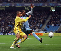 Photo: Paul Thomas.<br /> Manchester City v Sheffield Wednesday. The FA Cup. 16/01/2007.<br /> <br /> Man City's Sylvain Distin (R) battles with Marcus Tuogay.