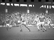 The All Ireland Senior Football Final.1982.19.09.1982.09.19.1982.19th September 1982..The senior final was contested between Offaly and Kerry. Offaly won the title by the narrowest of margins 1.15 to 17 points..Liston powers his way to goal as O'connor moves to intercept.