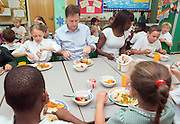 ***EMBARGO 12.01AM Tuesday 17 June.*** © Licensed to London News Pictures. 12/06/2014. Wallington, UK. Lorraine Pascale and Nick Clegg eat lunch with the schoolchildren.  Ahead of an announcement on new food standards for schools, Deputy Prime Minister Nick Clegg and celebrity chef Lorraine Pascale visit Foresters Primary School where they picked fruit with schoolchildren from the school's vegetable patch, prepared a fruit salad, helped the school chefs to serve food and sat with the children as they ate lunch. Photo credit : Stephen Simpson/LNP