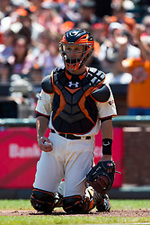 SAN FRANCISCO, CA - MAY 26: Buster Posey #28 of the San Francisco Giants kneels behind home plate with a baseball against the Colorado Rockies during the second inning at AT&T Park on May 26, 2013 in San Francisco, California. The San Francisco Giants defeated the Colorado Rockies 7-3. (Photo by Jason O. Watson/Getty Images) *** Local Caption *** Buster Posey