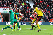 Mark Travers (42) of AFC Bournemouth makes a save from Troy Deeney (9) of Watford during the Premier League match between Bournemouth and Watford at the Vitality Stadium, Bournemouth, England on 12 January 2020.