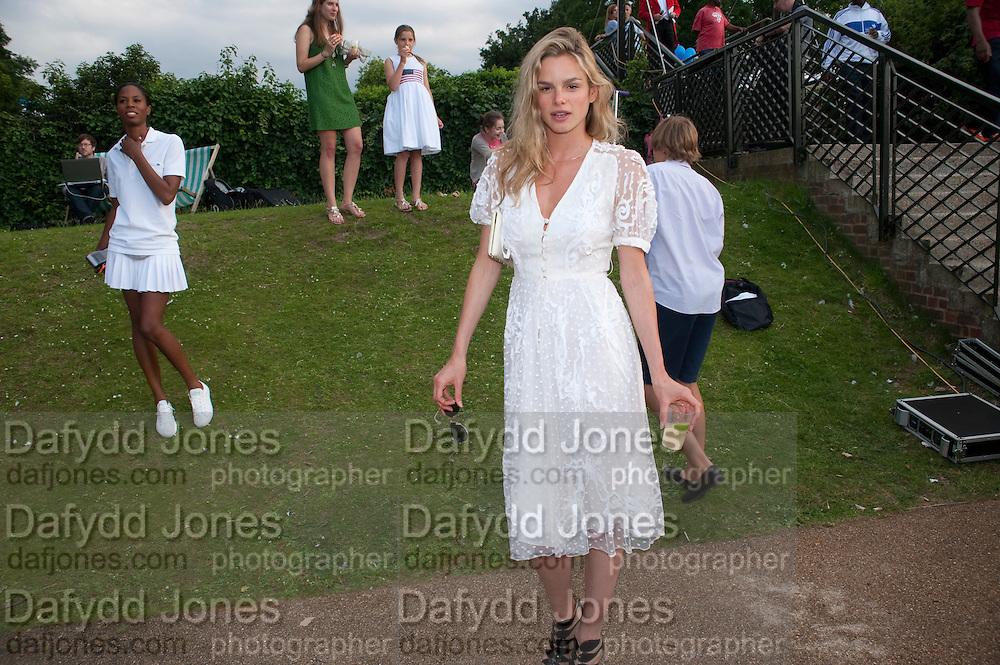 SAMMY AKIWUMI; NATASHA GILBERT, Chucs Dive & Mountain Shop charity Swim Party: Lido at The Serpentine. London. 4 July 2011. <br /> <br />  , -DO NOT ARCHIVE-© Copyright Photograph by Dafydd Jones. 248 Clapham Rd. London SW9 0PZ. Tel 0207 820 0771. www.dafjones.com.