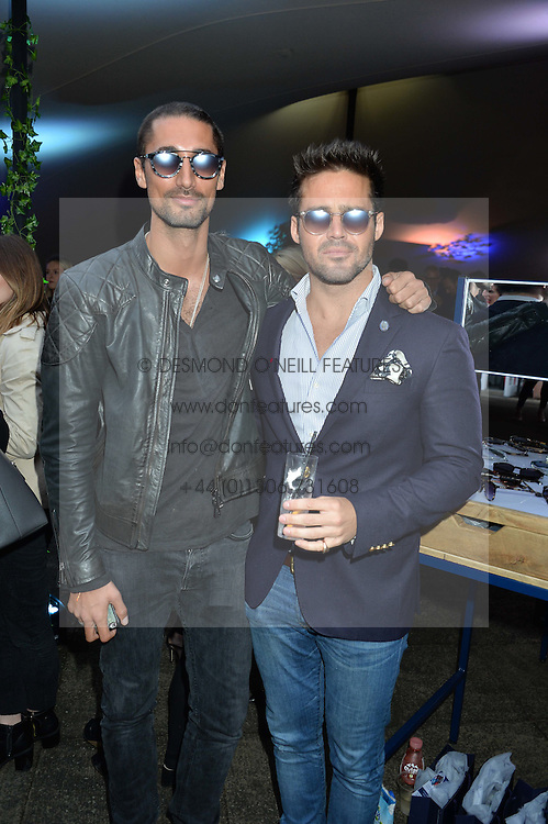 Left to right, HUGO TAYLOR and SPENCER MATTHEWS and guest at a party to launch the Taylor Morris Explorer Collection held at the Serpentine Lido, Hyde Park, London on 11th May 2016.