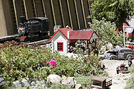 A g-scale train passes a town on it's way across the back yard of Gary and Joni Sines' 'Narrow Minded &<br />Clear Cut Logging Co. RR.' during the open garden tour for garden railroad clubs from Cincinnati, Columbus and Indianapolis, Sunday, July 15, 2007.