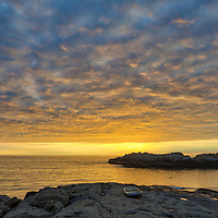Coastal New England featuring the seascape of Cape Neddick captured at sunrise in York, ME. Loved watching this sunrise become alive and capturing the boat on the rocks and the beautiful sky Atlantic Ocean scenery.  Early morning is my favorite time of the day, when I can enjoy quietude and solitude.<br />