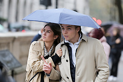 © Licensed to London News Pictures. 01/11/2019. London, UK. A couple shelters from the rain underneath an umbrella on a wet and milder November day in Westminster, London. Photo credit: Dinendra Haria/LNP