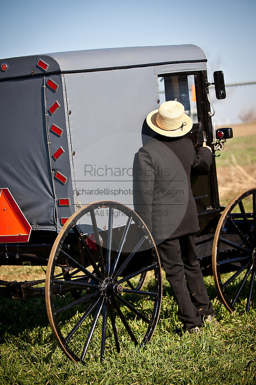 Amish boy inspects a horse buggy during the Annual Mud Sale to support the Fire Department  in Gordonville, PA.