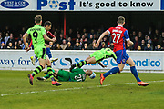 Forest Green Rovers Omar Bugiel(11) is brought down by Dagenham goalkeeper Mark Cousins(30), penalty awarded during the Vanarama National League first leg play off match between Dagenham and Redbridge and Forest Green Rovers at the London Borough of Barking and Dagenham Stadium, London, England on 4 May 2017. Photo by Shane Healey.