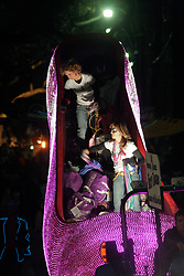 Feb 23rd, 2006. New Orleans, Louisiana. The Krewe of Muses. Muses is the only all women's Krewe to parade in New Orleans and is known for its satire, famous shoe throws and is generally considered one of the most popular parades of the Mardi Gras. Crowds scream and cheer for beads and throws from the famous Krewes' floats as they roll along St Charles Avenue.