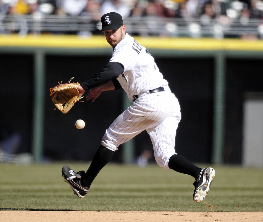 CHICAGO - APRIL 03:  Jeff Keppinger #7 the Chicago White Sox makes a backhanded grab on a ground ball during the game against the Kansas City Royals on April 3, 2013 at U.S. Cellular Field in Chicago, Illinois.  The White Sox defeated the Royals 5-2.  Ramirez was charged with an error on the play.(Photo by Ron Vesely)   Subject: Jeff Keppinger