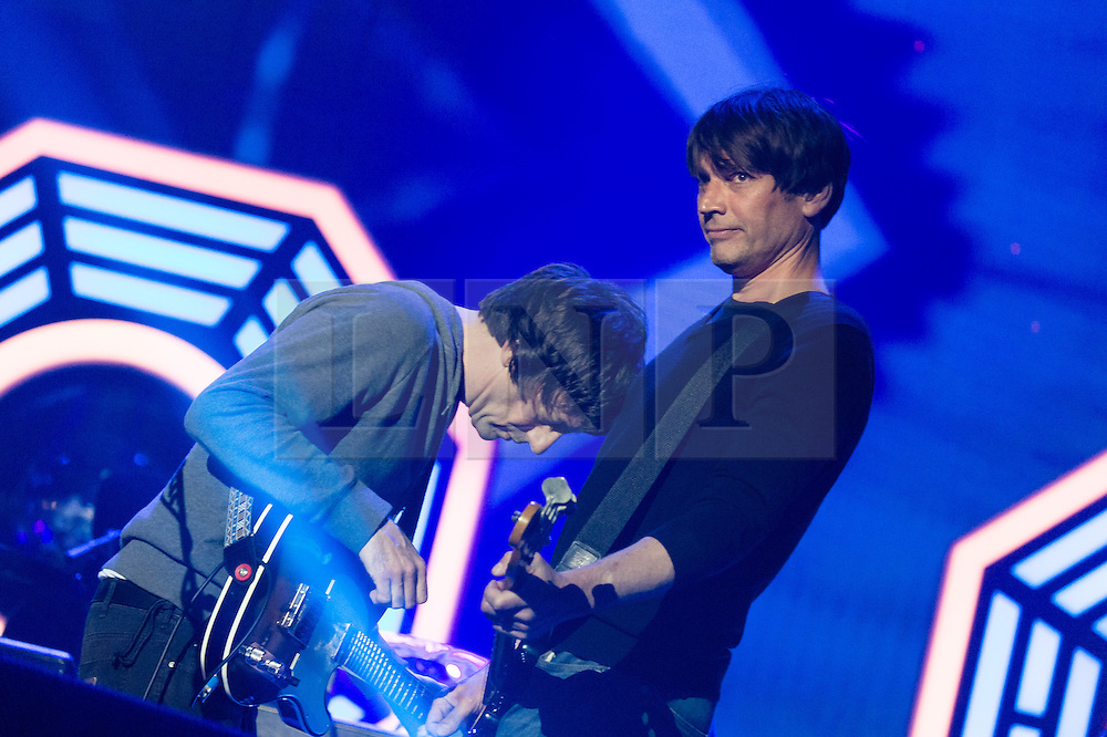 © Licensed to London News Pictures. 13/06/2015. Isle of Wight, UK.   Blur performing live at Isle of Wight Festival 2015, Day 3 Saturday,headlining the main stage.   In this picture - Graham Coxon (left), Alex James (right)Headline acts include The Prodigy, Blur and Fleetwood Mac.   Photo credit : Richard Isaac/LNP