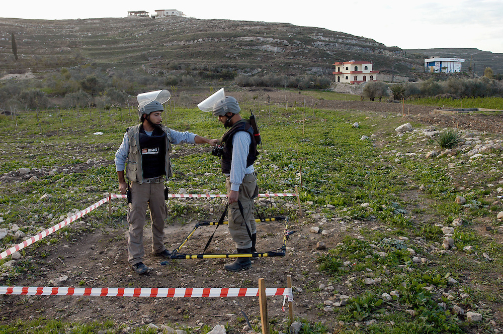 Deminers from Mines Advisory Group (MAG) prepare to clear some of the millions of cluster sub-munitions and other remnants of war scattered across southern Lebanon..Aadchit, Lebanon. 25/11/2008..Photo © J.B. Russell