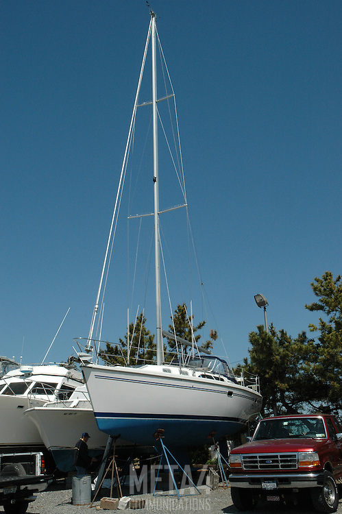 Catalina 350 sailboat on jackstands in boatyard being prepped for spring launch.